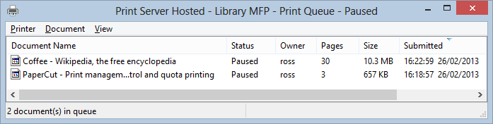 A view of the print queue showing test jobs paused in the print queue